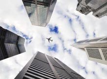 View of skyscrapers and airplane